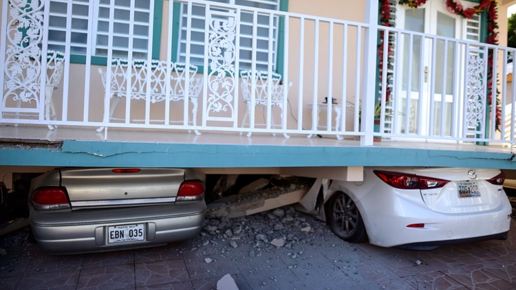 Puerto Rico Earthquake cars crushed under home AP