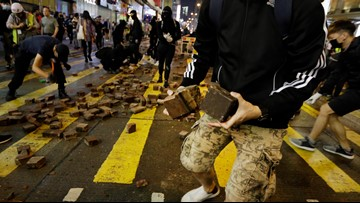Hong Kong protester appears shot by police in online video