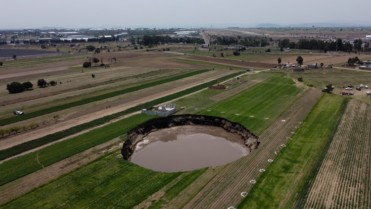 Sinkhole at Mexico farm swallows more land, traps 2 dogs