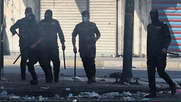 Iraqi forces kill 6 protesters, retake key Baghdad bridges