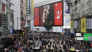 Hong Kong protesters occupy major shopping district