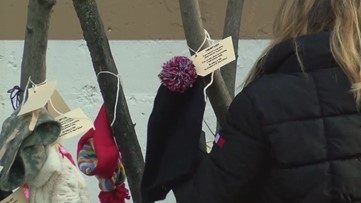 St. Pius students decorate downtown Toledo with free, donated winter accessories to keep everyone warm