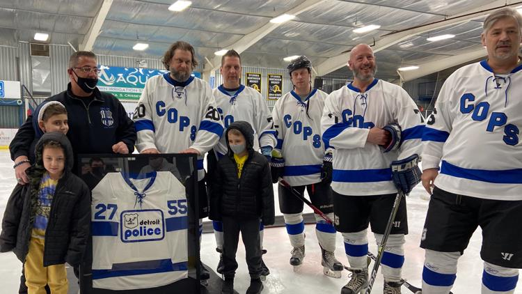 Police face off in charity hockey game with a goal of honoring fallen officers and protecting others