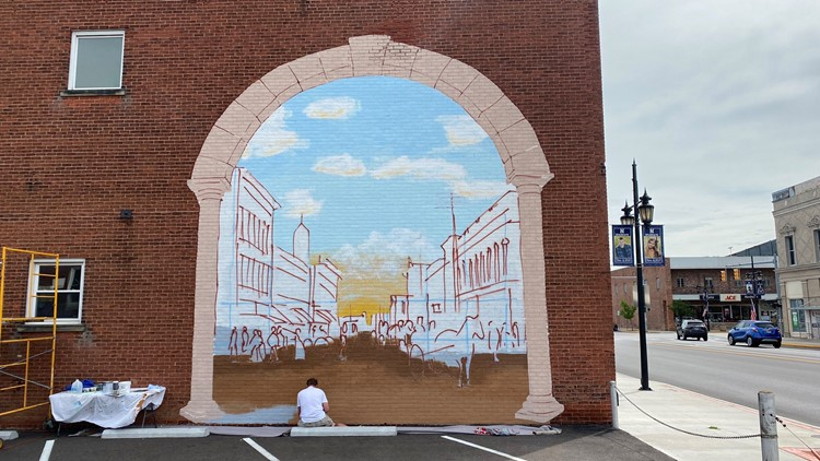Historic mural going up on downtown Napoleon building
