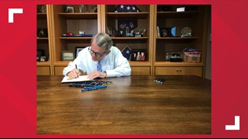 Ohio Governor Mike DeWine signs state budget