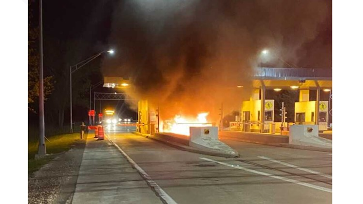 Car engulfed in flames at Ohio Turnpike toll booth; driver, dog escape safely