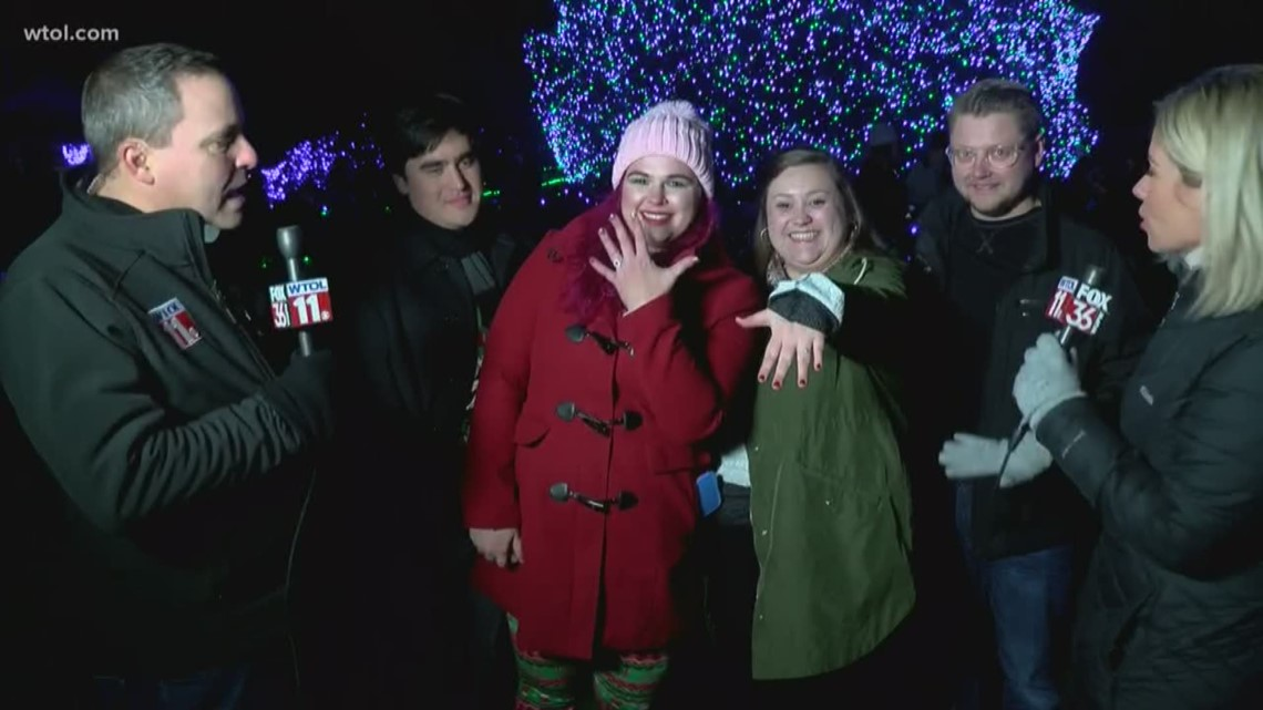 What's that extra sparkle? 2 couples get engaged right by The Big Tree