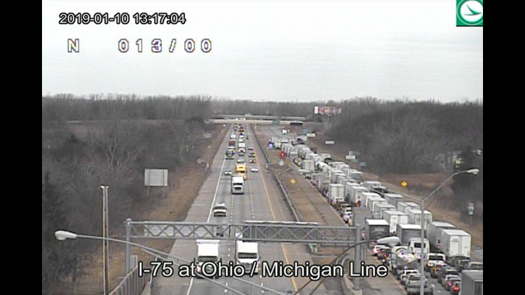 Traffic on I-75 northbound stopped just north of Alexis Rd