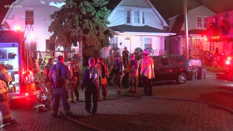 Father saves son as family of 5 jumps from 2nd floor window to escape south Toledo house fire
