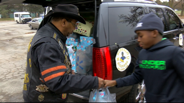 Buffalo Soldiers deliver toys at YMCA for Christmas