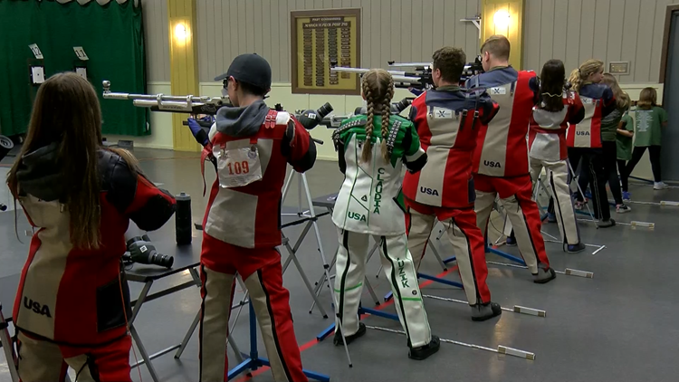 Five members of northwest Ohio Air Rifle team getting their shot in the Junior Olympics