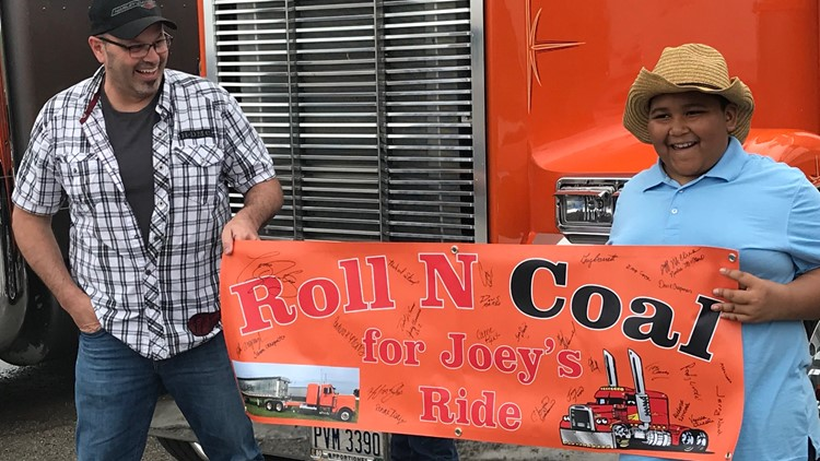 Joey Coppes holding sign