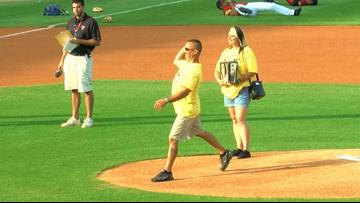 Man who lost two children to addiction throws first pitch at Fifth-Third Field