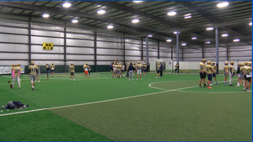 Area football teams forced to practice indoors due to weather
