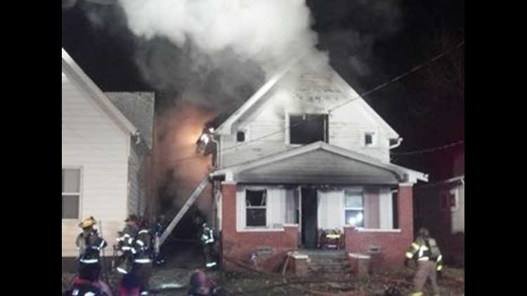 Crews battle house fire in central Toledo