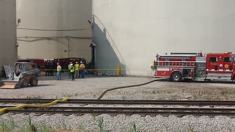 Toledo Fire and Rescue crews on scene of people trapped in an Andersons grain silo