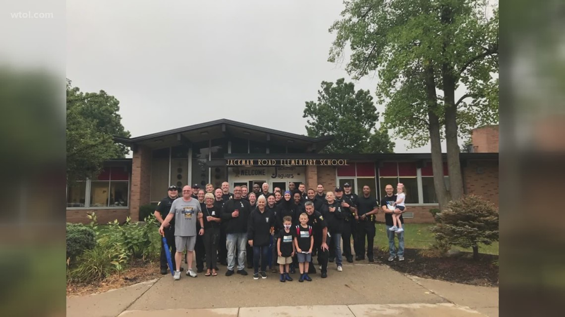 Dozens of TPD officers walk Officer Dia's sons to school