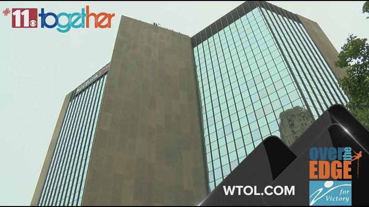 Rappel a 16-story building to help raise money for cancer patients, survivors