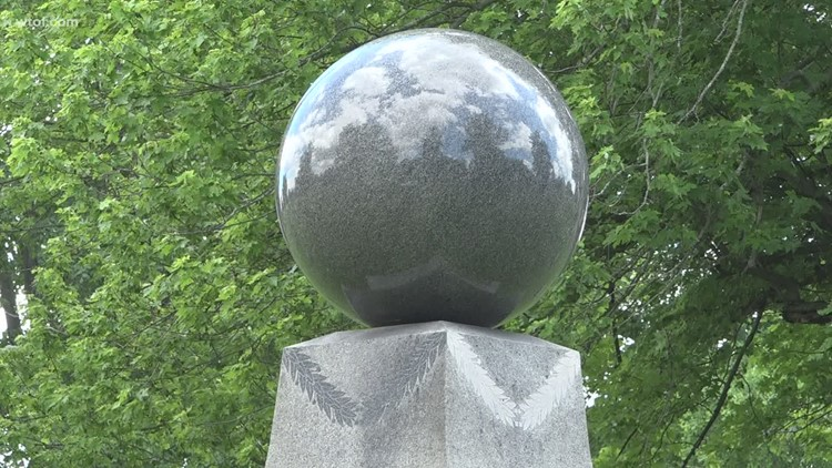 Wow, That's Weird: Moving 5,000-pound ball at Marion cemetery intrigues visitors